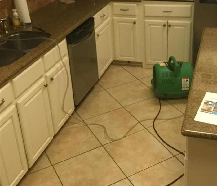Air movers drying kitchen